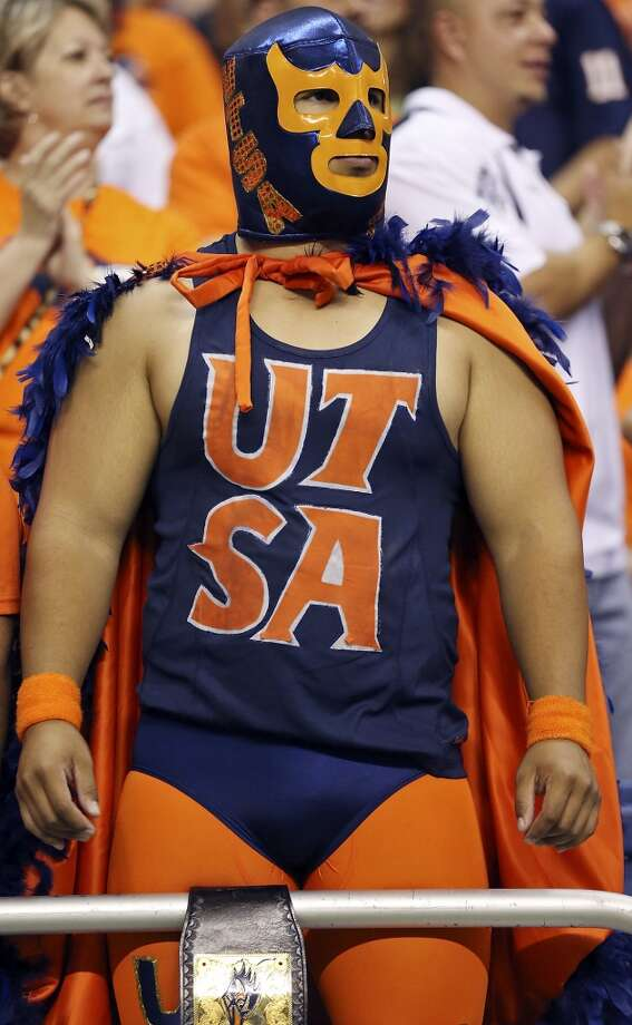 "UTSA alumnus George ""El Gran Beak"" De Leon takes in the sight during the game with the University of Houston Saturday Sept. 28, 2013 at the Alamodome. Photo: San Antonio Express-News"