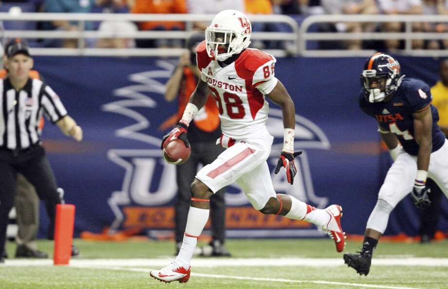 University of Houston's Xavier Maxwell scores a touchdown as UTSA' s Crosby Adams III looks on during second half action Saturday Sept. 28, 2013 at the Alamodome. The University of Houston won Photo: San Antonio Express-News