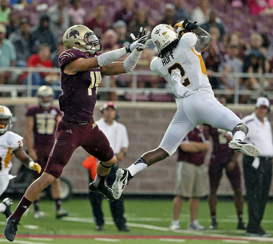 A pass intended for Texas State's Bradley Miller (left) is picked off by Wyoming defensive back Marqueston Huff in the second quarter. Photo: Photos By Tom Reel / San Antonio Express-News