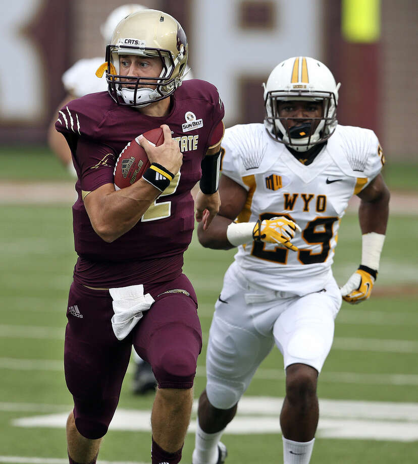 Bobcats quarterback Tyler Jones breaks out for a long run in the first quarter of Texas State's home game with Wyoming.