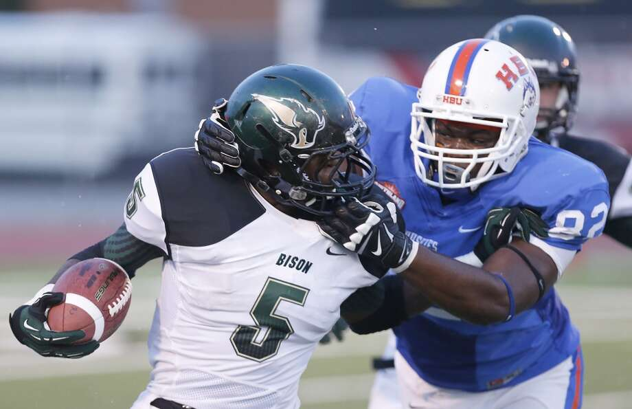Kameron Lecoq #82 of the HBU Huskies tackles Darrl Fields #5 of the Oklahoma Baptist Bison. Photo: Thomas B. Shea, Houston Chronicle