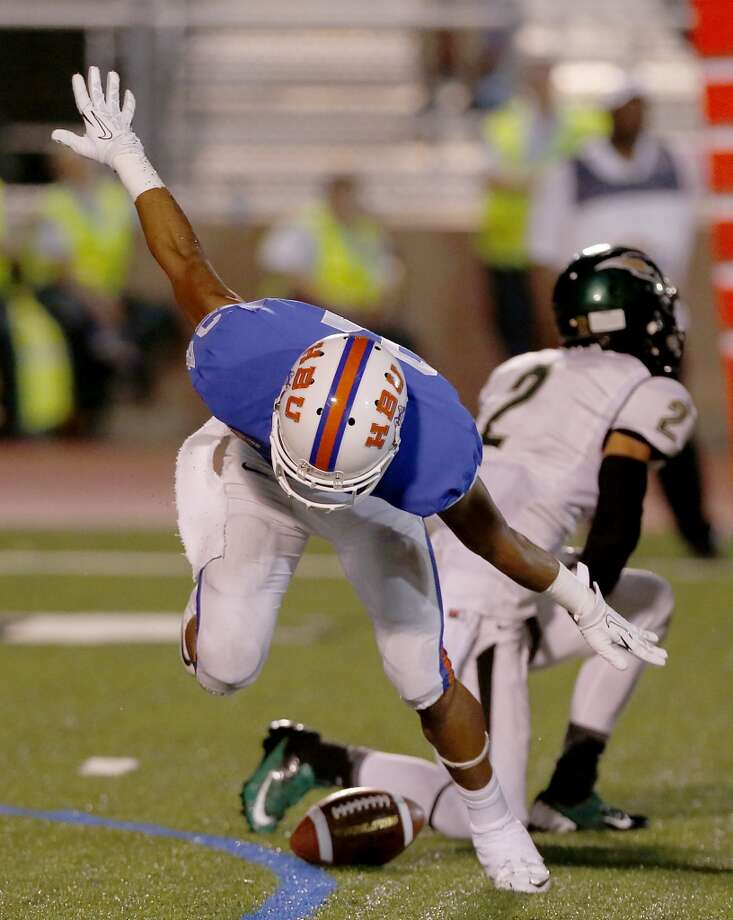 Joseph Ward #24 of the HBU Huskies celebrates his interception against Darian Lazard #2. Photo: Thomas B. Shea, Houston Chronicle