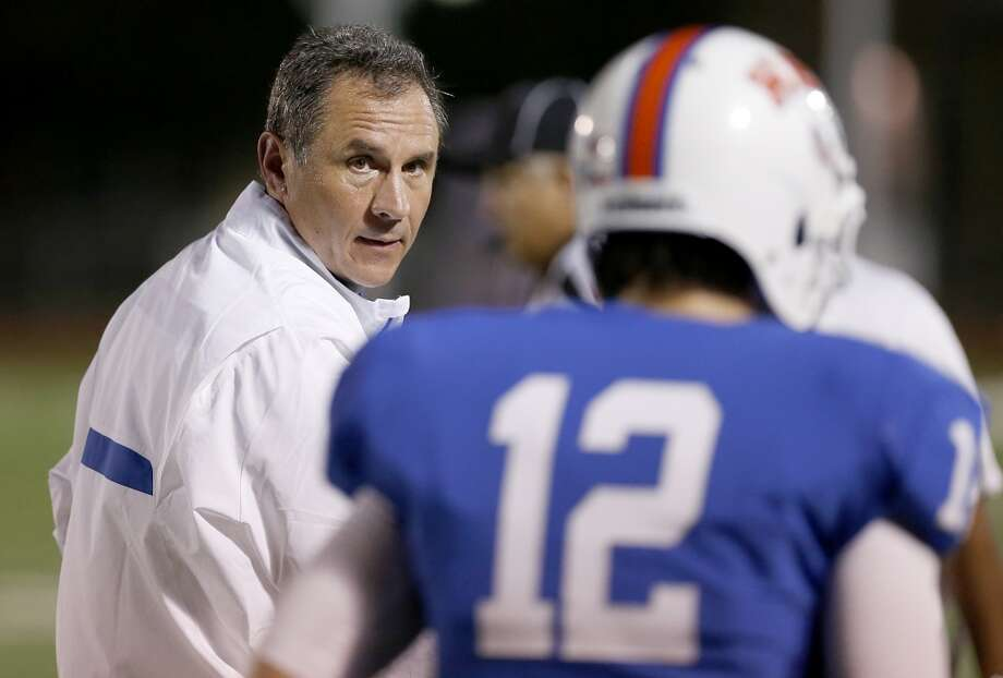 Head coach Vic Shealy scowls at punter David Dunkin #12 of the HBU Huskies after shanking his second punt. Photo: Thomas B. Shea, Houston Chronicle