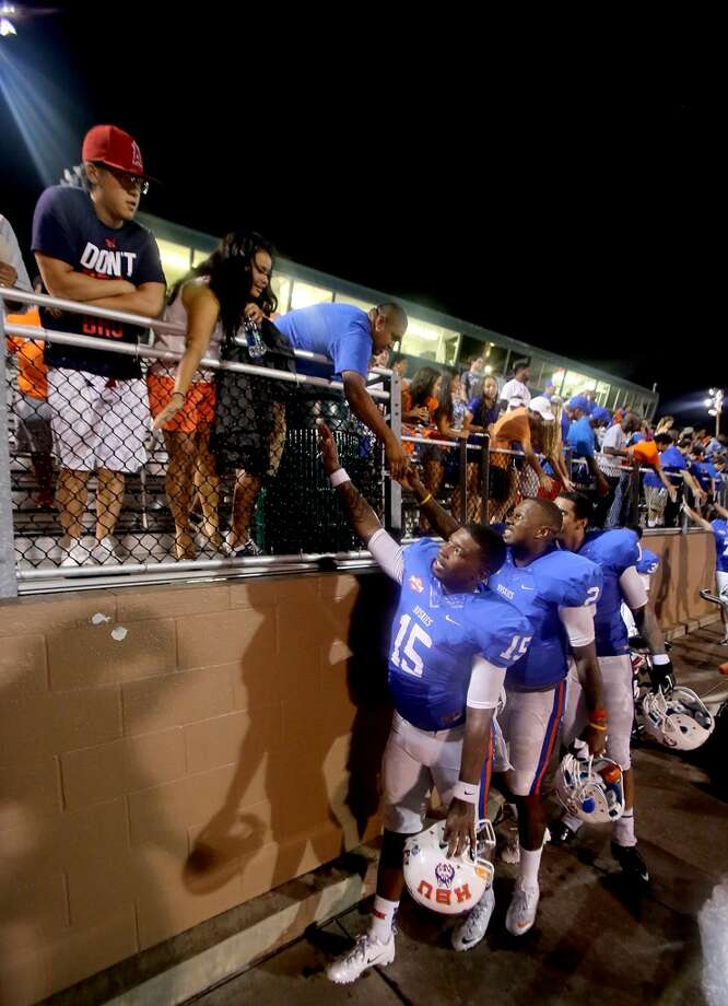 QB Ka'Darius Baker #15 of the HBU Huskies shakes hands with the crowd after HBU defeated the Oklahoma Baptist Bison. Photo: Thomas B. Shea, Houston Chronicle