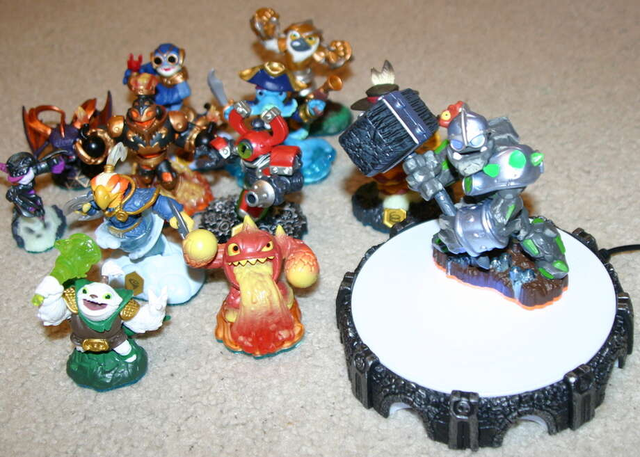 "Here's a shot of the new ""Skylanders Swap Force"" creatures, as well as the new, slimmer portal. Photo: M4d Ski11z, Willie Jefferson Jr."