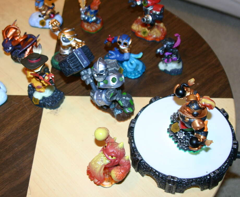 "Here's a shot of the new ""Skylanders Swap Force"" creatures, as well as the new, slimmer portal. Photo: Willie Jefferson Jr."