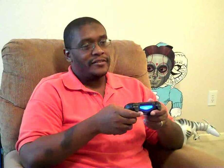 "M4d Ski11z played the ""Skylanders Swap Force"" demo on a Sony PlayStation 4. Here's he's pictured with a DUALSHOCK 4 controller. Photo: M4d Ski11z, Willie Jefferson Jr."