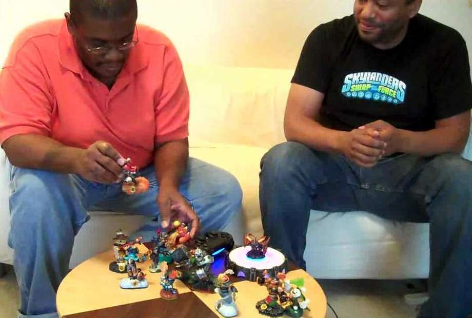 "Chris Wilson, a producer with Activision, explains ""Skylanders Swap Force"" to M4d Ski11z at Willie Jefferson Jr.'s house in Houston, Texas. Photo: Willile Jefferson Jr., Willie Jefferson Jr."
