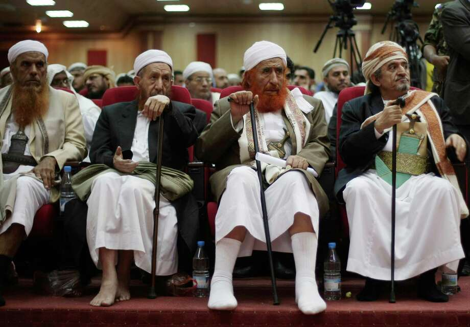 Sheik Sadeq al-Ahmar, head of Yemen's powerful Hashid tribe, right, and Abdul Majid al-Zindani, a religious hard-line leader in Yemen, second right, attend a press conference in Sanaa, Yemen, Thursday, Sept. 26, 2013. Al-Zindani called for stronger role for Islamic law in the Arab country's new constitution after some politicians taking part in the country's critical national dialogue talks called for a quota for women on the panel that will draft the charter. Photo: AP
