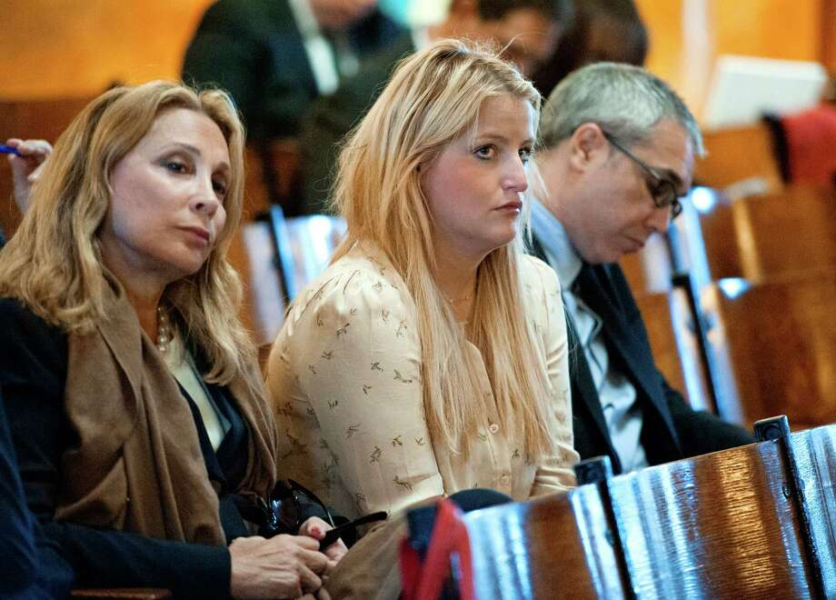 This Sept. 23, 2013 photo, Samantha Perelman, daughter of billionaire Ronald Perelman,  and granddaughter of the late Hudson News patriarch Robert Cohen, center, looks on during opening arguments in her lawsuit against the Cohen family in Superior Court in Hackensack, N.J.  Samantha Perelman claims her uncle, James Cohen,,  systematically squeezed her out of her grandfather's will during the last several years of Robert Cohen's life as he suffered from the debilitating effects of a Parkinson's-like disease before dying in 2012. Photo: AP