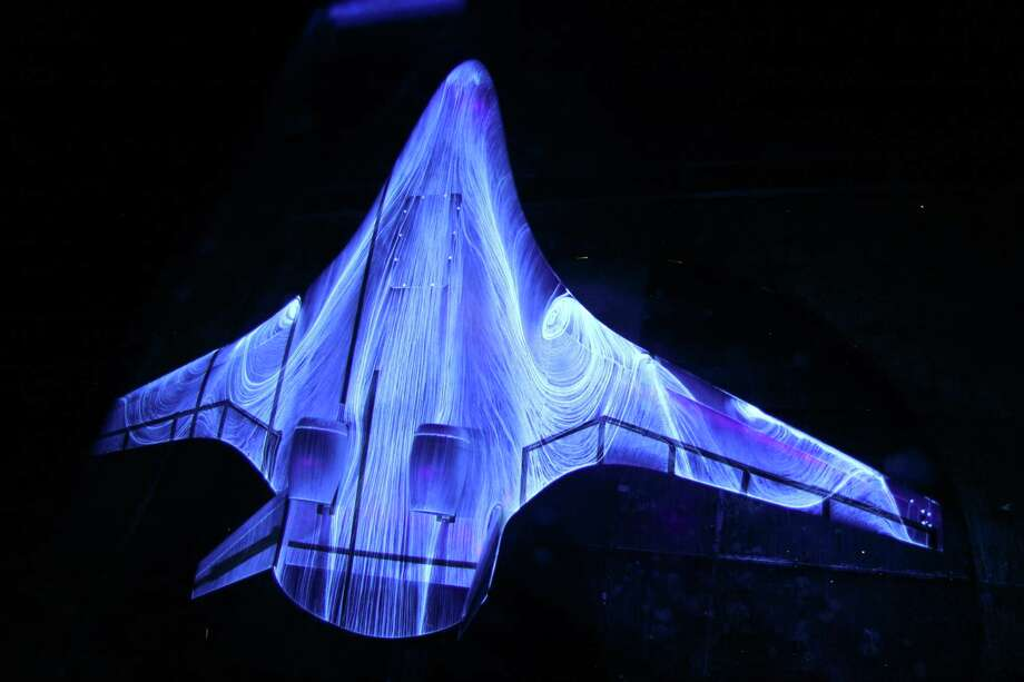"This 2013 image provided by NASA on Friday, Sept. 27, 2013 shows a photo of fluorescent oil on a 5.8 percent scale model of a hybrid wing body aircraft during tests in the 14 by 22 Foot Subsonic Wind Tunnel at the NASA Langley facility in Hampton, Va. The oil helps researchers ""see"" the flow patterns when air passes over and around the model. Those patterns are important in determining crucial aircraft characteristics such as lift and drag. Photo: AP"