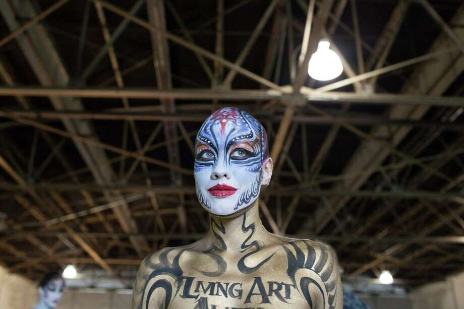 Atlanta model Metti June poses at the Living Art America - Bodies as a Work of Art body painting competition Saturday, Sept. 28, 2013 in Atlanta, GA. Forty artists from nine countries are competing in the first sanctioned World Bodypainting Association event held in the United States. Photo: AP