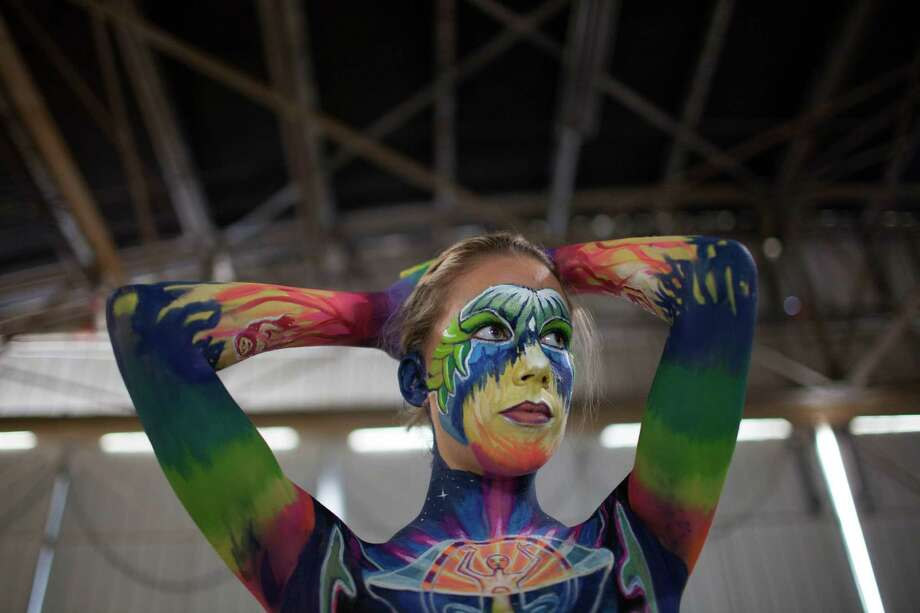 Italian model Valeria Hasler holds still as she is painted during the Living Art America - Bodies as a Work of Art body painting competition Saturday, Sept. 28, 2013 in Atlanta, GA. Forty artist from nine countries are competing in the first sanctioned World Bodypainting Association event held in the United States. Photo: AP