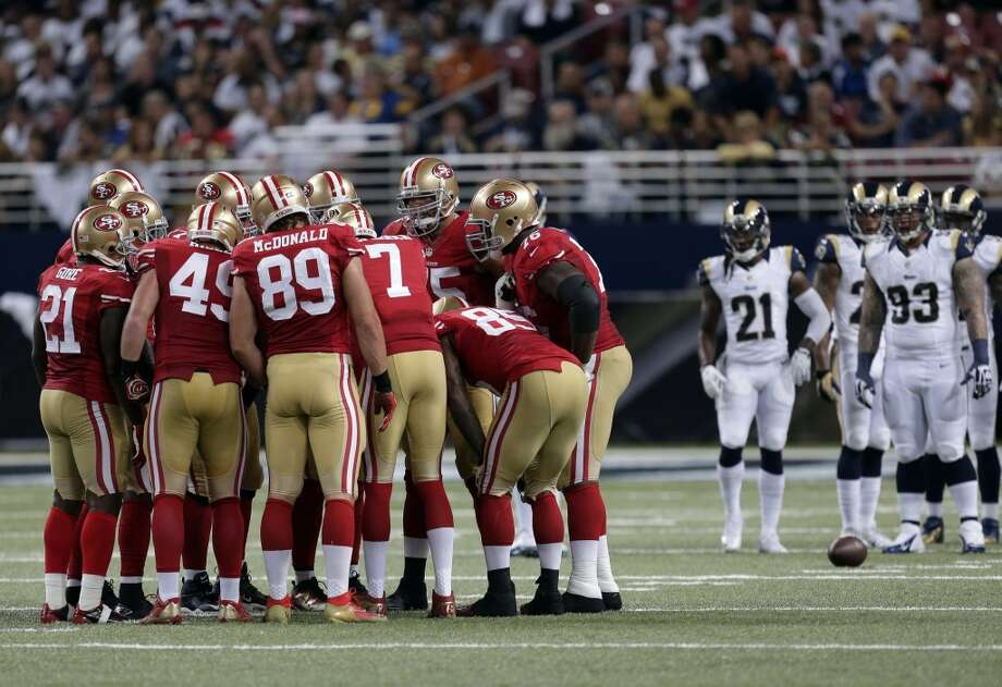 Members of the San Francisco 49ers huddle during the second quarter of an NFL football game against the St. Louis Rams Thursday, Sept. 26, 2013, in St. Louis. Photo: Charlie Riedel, Associated Press