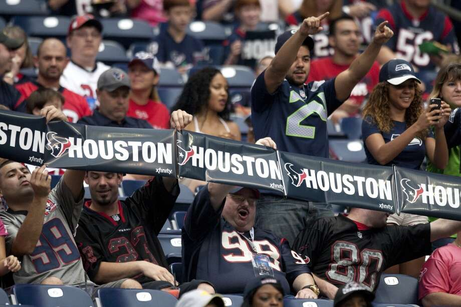 Texans and Seahawks fans cheer as the teams run onto the field. Photo: Brett Coomer, Houston Chronicle