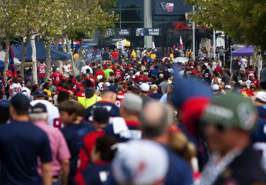 Texans fans wait to cross the street before the Texans take on the Seahawks. Photo: Cody Duty, Houston Chronicle