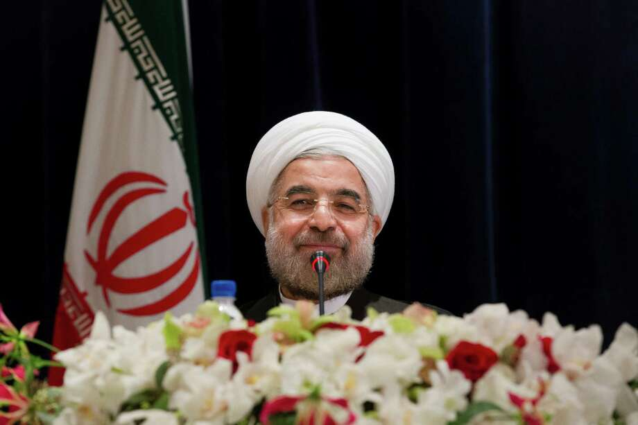 Iranian President Hassan Rouhani smiles at the end of a press conference at the Millennium Hotel in midtown Manhattan on Friday. Photo: John Minchillo, Associated Press / FR170537 AP