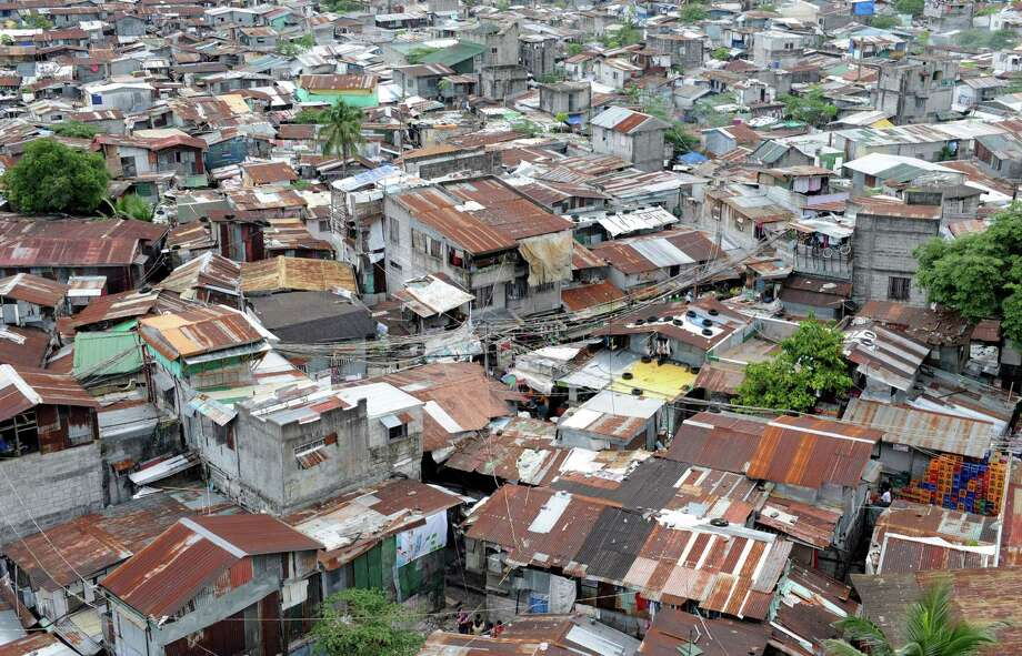A general view shows a large slum area in a suburb of Manila. Yhe Philippines is aiming to lift more than 10 million people out of poverty in less than two years, and make an enduring impact on lessening one of Asia's worst rich-poor divides. Photo: JAY DIRECTO, AFP/Getty Images / AFP