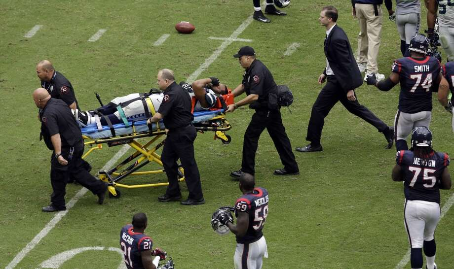 Seattle Seahawks' Michael Bennett is carted off the field after he was injured during the second quarter an NFL football game against the Houston Texans, Sunday, Sept. 29, 2013, in Houston. Photo: David J. Phillip, Associated Press