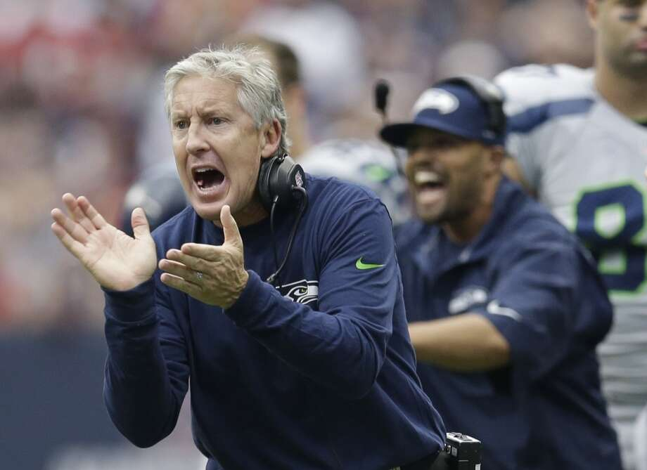 Seattle Seahawks head coach Pete Carroll talks to his players during the first quarter an NFL football game against the Houston Texans, Sunday, Sept. 29, 2013, in Houston. Photo: David J. Phillip, Associated Press