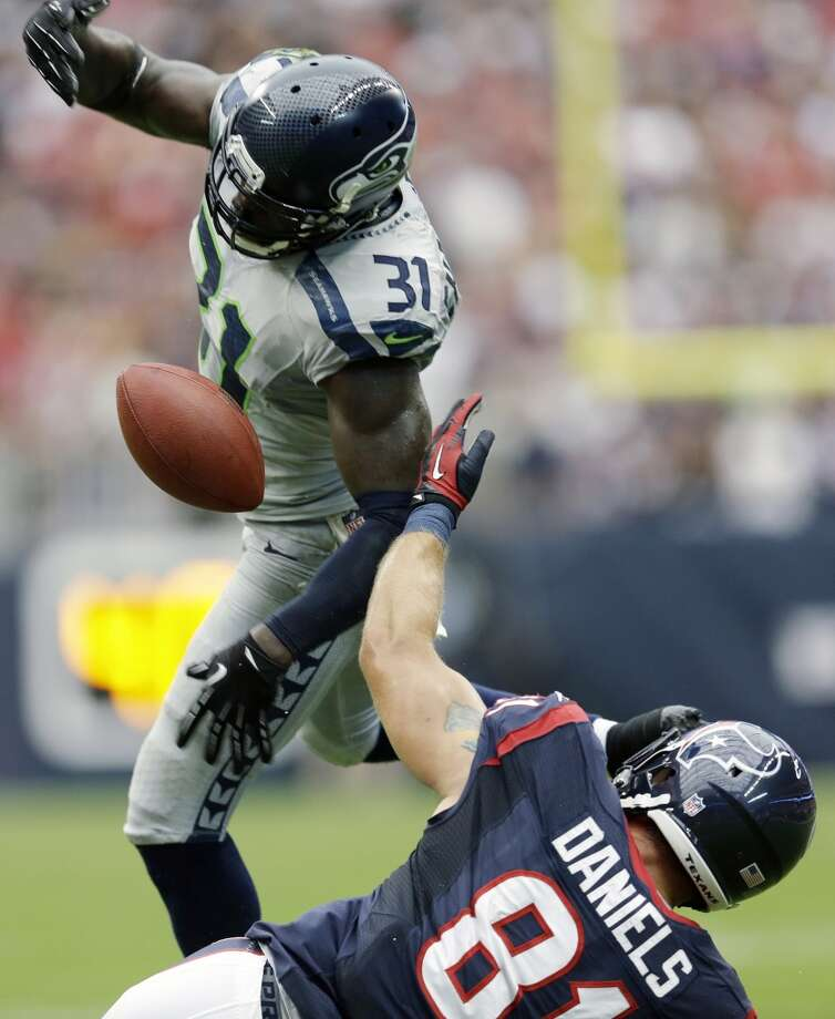 Seattle Seahawks' Kam Chancellor (31) breaks up a pass intended for Houston Texans' Owen Daniels (81) during the first quarter an NFL football game on Sunday, Sept. 29, 2013, in Houston. Seahawks' Earl Thomas made an interception off the tipped ball. Photo: David J. Phillip, Associated Press