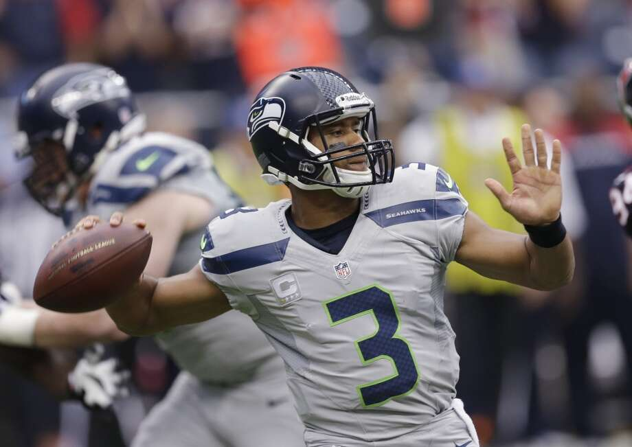Seattle Seahawks' Russell Wilson throws against the Houston Texans during the first quarter an NFL football game Sunday, Sept. 29, 2013, in Houston. Photo: David J. Phillip, Associated Press