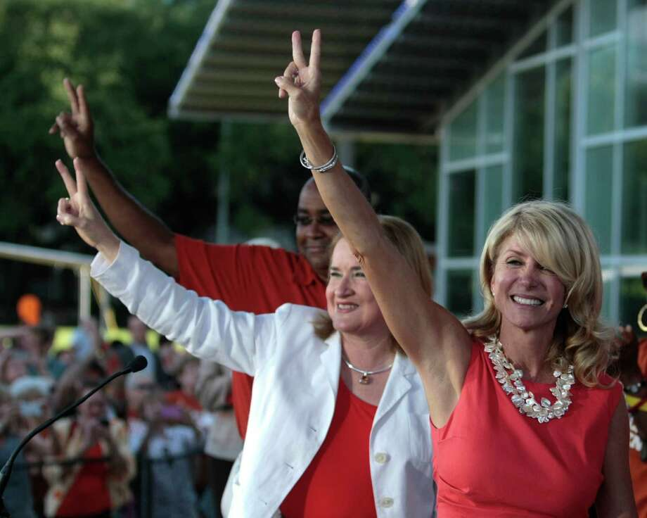 (l-r) Texas State Senators Rodney Ellis, Sylvia Garcia and Wendy Davis greet the crowd during the Planned Parenthood Action Fund's Stand with Texas Women Rally at Discovery Green in Houston, Texas. The Rally highlighted the abortion restriction bill, House Bill 2 being Pushed in Austin. The Parenthood Action Fund will held the rally in Houston as part of the statewide Stand with Texas Women tour. Tuesday, July 9, 2013, in Houston. ( Billy Smith II / Chronicle ) Photo: Billy Smith II, Houston Chronicle / © 2013 Houston Chronicle
