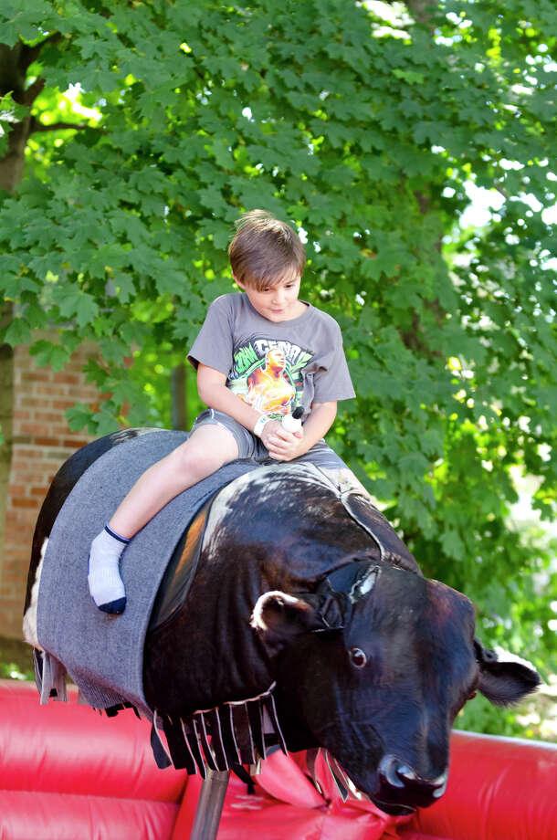 Demetre Zoumboulis, 7, of Stamford, rides the mechanical bull during the final day of the Greek Fest held at Archangels Greek Orthodox Church on Bedford Street in Stamford on Sunday, Sept. 29, 2013. Photo: Amy Mortensen