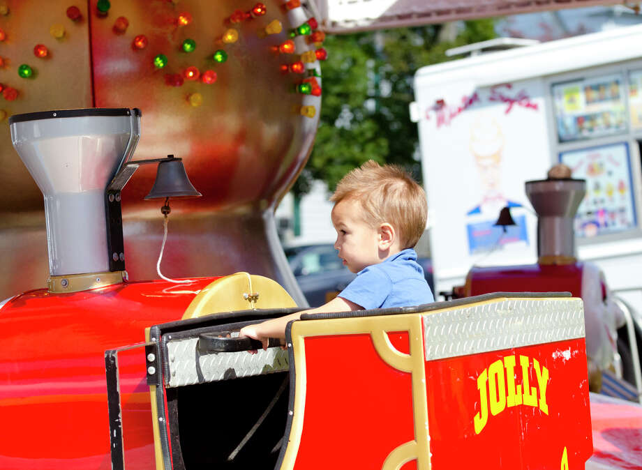 """Alec, 1.5, of Stamford, rides the """"Jolly Choo-Choo""""  during the final day of the Greek Fest held at Archangels Greek Orthodox Church on Bedford Street in Stamford on Sunday, Sept. 29, 2013. Photo: Amy Mortensen"""