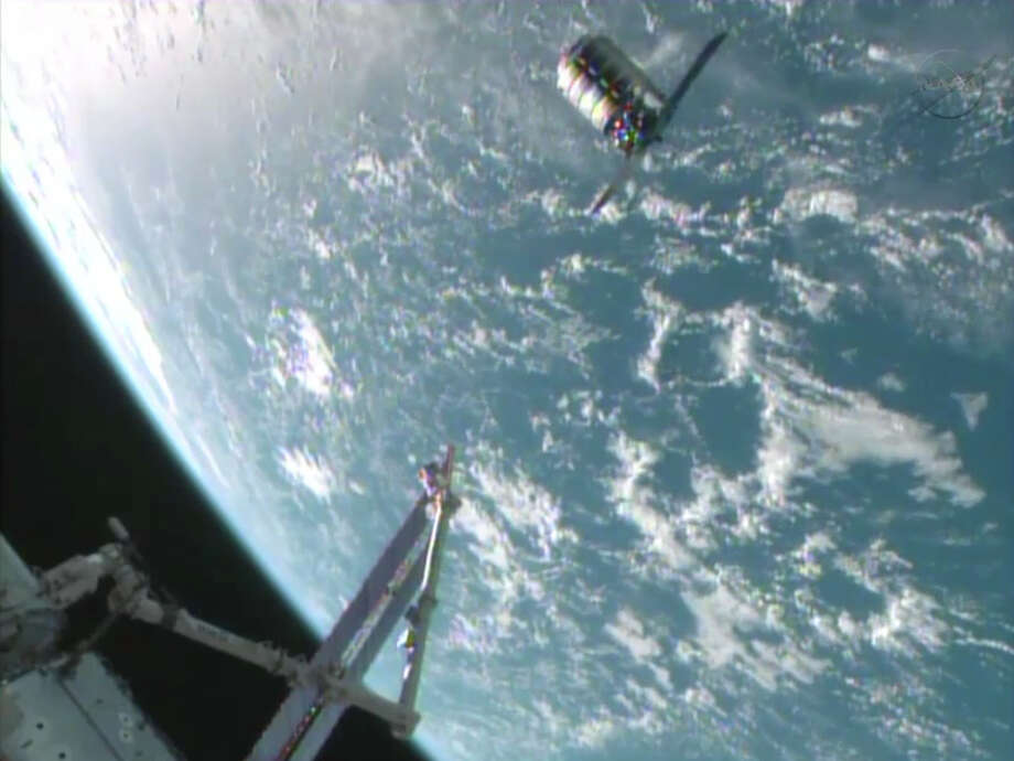 This framegrabbed image provided by NASA-TV shows the Cygnus spacecraft at the 30 meter hold point from the International Space Station Sunday Sept. 29, 2013 as both cross over the Atlantic Ocean. Photo: AP