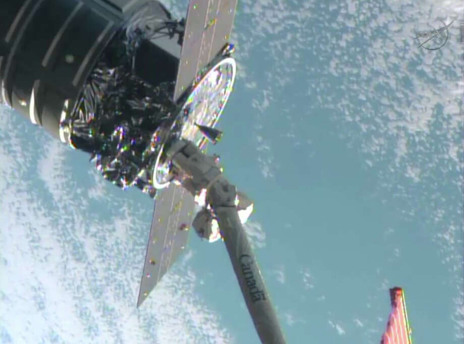 This framegrabbed image provided by NASA-TV shows the Cygnus spacecraft after it was captured by the robot arm on the International Space Station early Sunday Sept. 29, 2013. At the time both vehicles were traveling over the Indian Ocean. Photo: AP