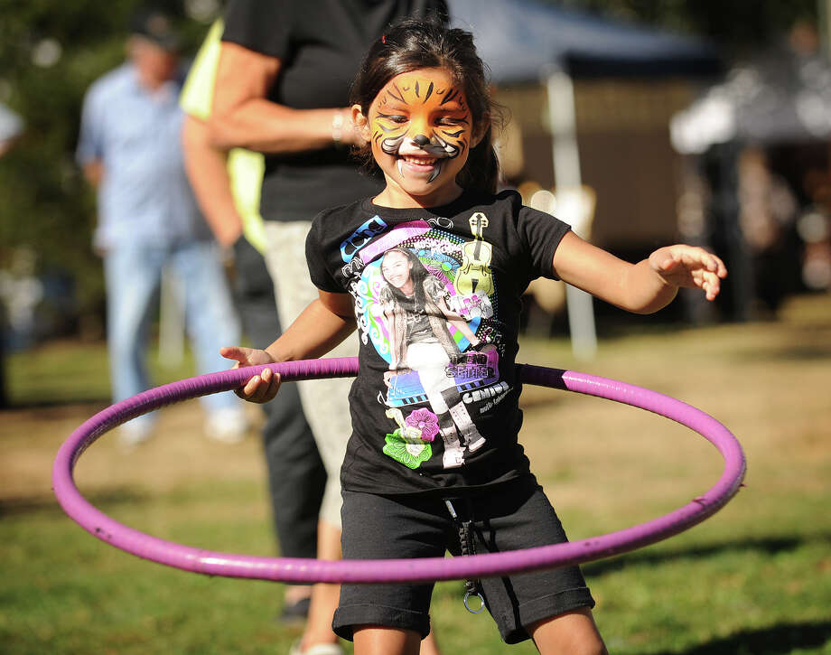 Abygail Prieto, 6, tries out a hula hoop from vendor Bring the Hoopla at the 36th Annual Harvest Festival on Paradise Green in Stratford, Conn. on Sunday, September 29, 2013. Photo: Brian A. Pounds / Connecticut Post