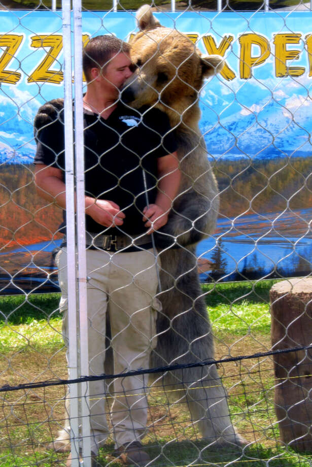Tonk the bear with owner/trainer Dexter Osborn. (Kathy Hedgeman)