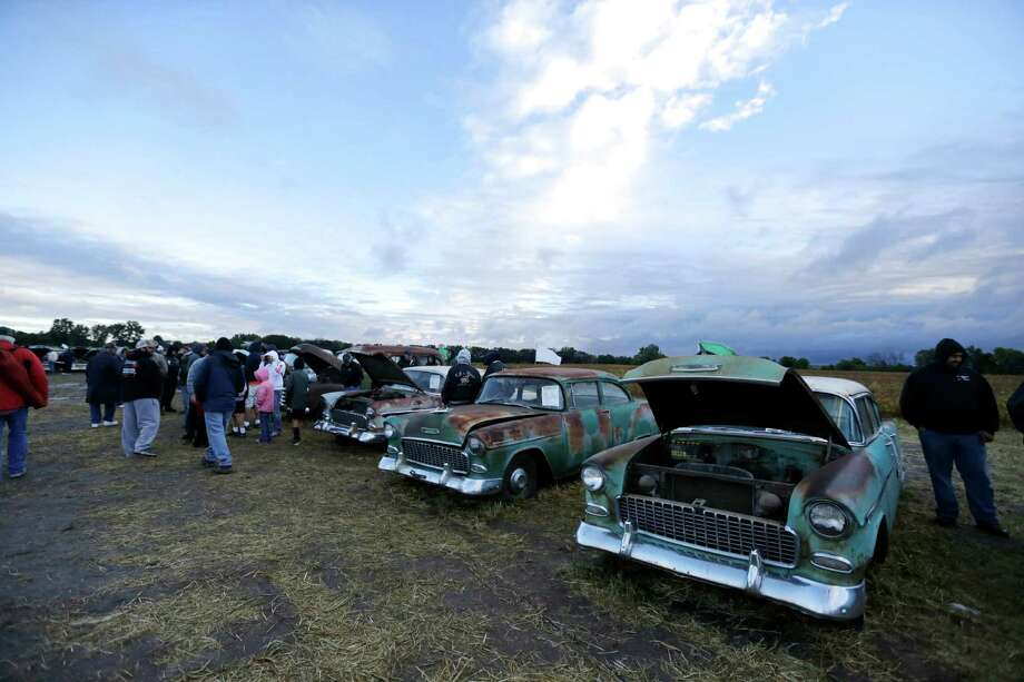 Cars are lined up at sunrise in a field, Saturday, Sept. 28, 2013, ahead of the Lambrecht Chevrolet auction in Pierce, Neb. The auction drew car buffs from around the world to the small northeast Nebraska town. Photo: AP