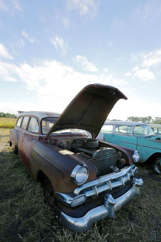 A 1954 Chevrolet Suburban awaits a buyer in a field, Saturday, Sept. 28, 2013, ahead of the Lambrecht Chevrolet auction in Pierce, Neb. The auction drew car buffs from around the world to the small northeast Nebraska town. Photo: AP