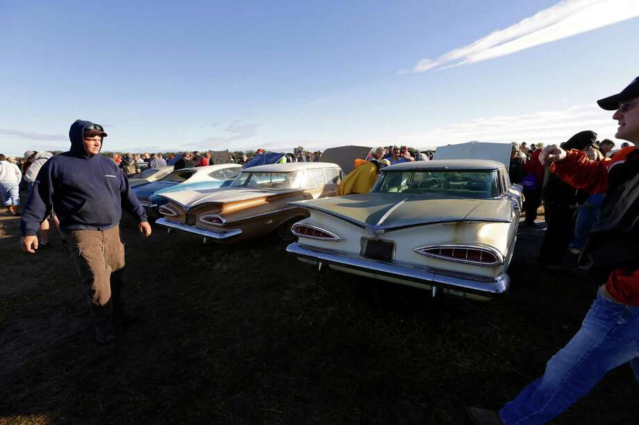Chevy Impalas are lined up at sunrise in a field, Saturday, Sept. 28, 2013, ahead of the Lambrecht Chevrolet auction in Pierce, Neb. The auction drew car buffs from around the world to the small northeast Nebraska town. Photo: AP