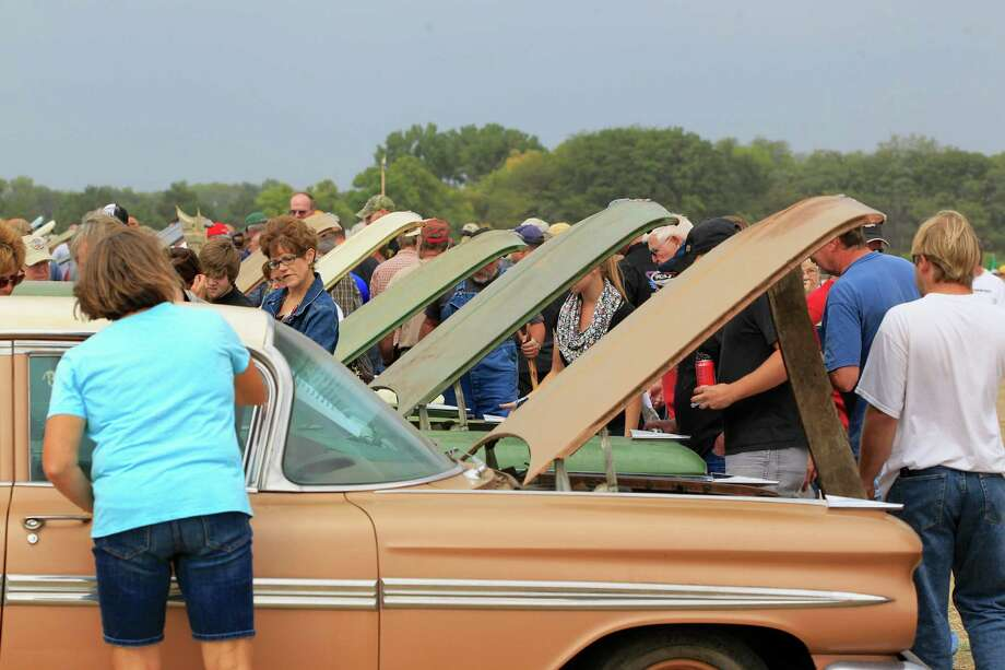 Cars are lined up for inspection during a preview for an auction of vintage cars and trucks from the former Lambrecht Chevrolet dealership in Pierce, Neb., Friday Sept. 27, 2013. Photo: AP