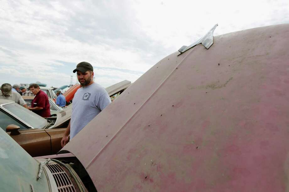 The hood ornament of a 1956 Chevrolet Belair points to the sky during a preview for an auction of vintage cars and trucks from the former Lambrecht Chevrolet dealership in Pierce, Neb., Friday Sept. 27, 2013. Photo: AP