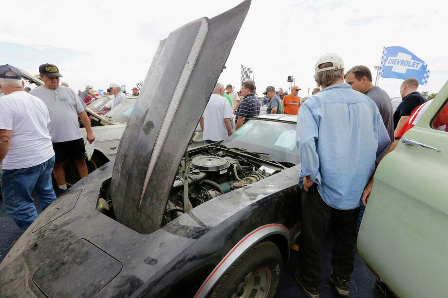 Car buffs look over a 1978 Chevrolet Corvette Pace Car during a preview for an auction of vintage cars and trucks from the former Lambrecht Chevrolet dealership in Pierce, Neb., Friday Sept. 27, 2013. Photo: AP