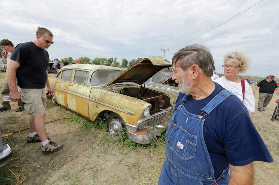 Car buffs walk past a yellow 1956 Chevrolet sedan during a preview for an auction of vintage cars and trucks from the former Lambrecht Chevrolet dealership in Pierce, Neb., Friday Sept. 27, 2013. Photo: AP
