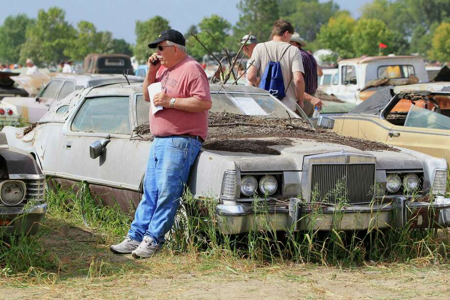 Cars are looked at during a preview for an auction of vintage cars and trucks from the former Lambrecht Chevrolet dealership in Pierce, Neb., Friday Sept. 27, 2013. Photo: AP