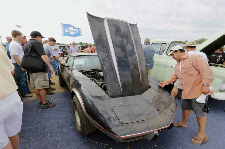 A 1978 Chevrolet Indy Corvette Pace Car is looked over during a preview for an auction of vintage cars and trucks from the former Lambrecht Chevrolet dealership in Pierce, Neb., Friday Sept. 27, 2013. Photo: AP