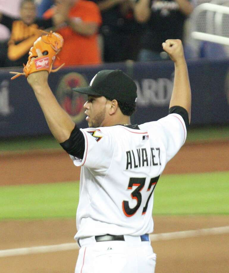 Miami Marlins pitcher Henderson Alvarez reacts after throwing a no-hitter against the Detroit Tigers in a baseball game in Miami, Sunday, Sept. 29, 2013. Miami defeated Detroit 1-0.  (AP Photo/El Nuevo Herald, Hector Gambino) ORG XMIT: FLMIH203 Photo: Hector Gabino / El Nuevo Herald