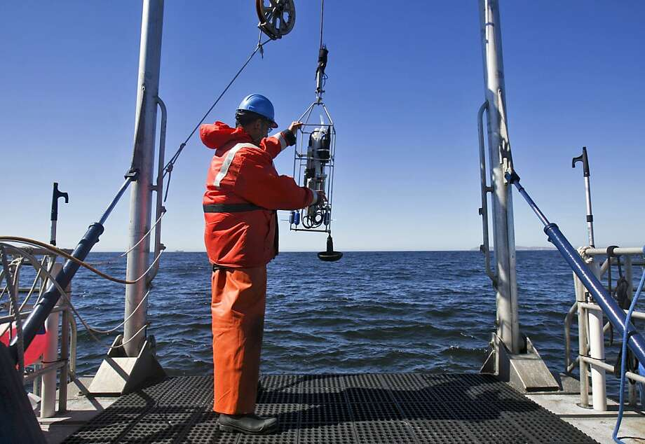 Jaime Jahncke, the lead ocean researcher for Point Blue Conservation Science, prepares to lower an instrument in the Gulf of the Farallones National Marine Sanctuary. He will also be testing the Whale Spotter app. Photo: Raphael Kluzniok, The Chronicle