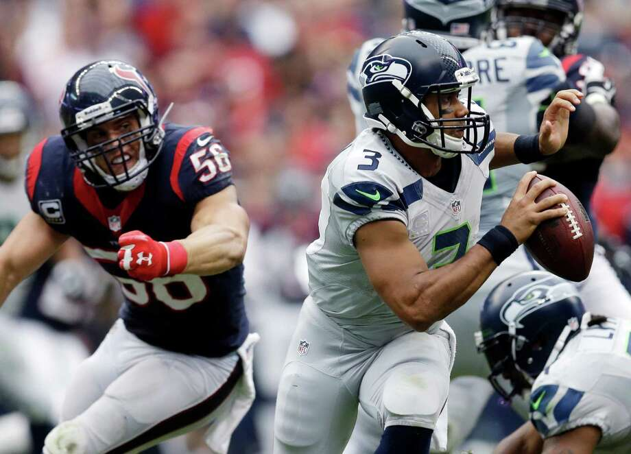 Seattle Seahawks' Russell Wilson (3) is pressured by Houston Texans' Brian Cushing (56) during the third quarter an NFL football game on Sunday, Sept. 29, 2013, in Houston. (AP Photo/David J. Phillip) Photo: David J. Phillip, Associated Press / AP