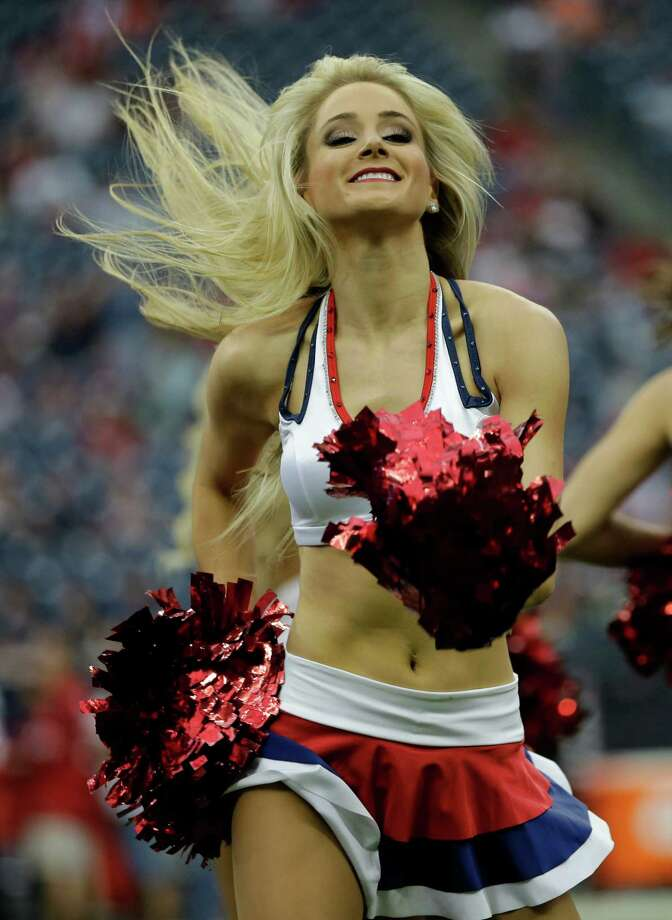 A Houston Texans cheerleader performs before an NFL football game against the Seattle Seahawks Sunday, Sept. 29, 2013, in Houston. (AP Photo/David J. Phillip) Photo: David J. Phillip, Associated Press / AP
