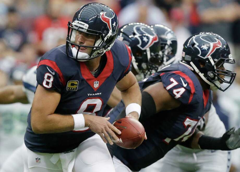 Houston Texans' Matt Schaub looks to hand the ball off during the first quarter an NFL football game against the Seattle Seahawks, Sunday, Sept. 29, 2013, in Houston. (AP Photo/Patric Schneider) Photo: Patric Schneider, Associated Press / FR170473