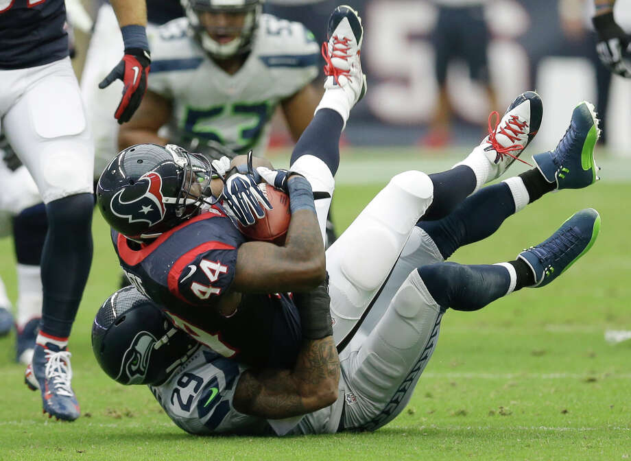 Houston Texans' Ben Tate (44) is stopped by Seattle Seahawks' Earl Thomas (29) during the first quarter an NFL football game Sunday, Sept. 29, 2013, in Houston. (AP Photo/David J. Phillip) Photo: David J. Phillip, Associated Press / AP