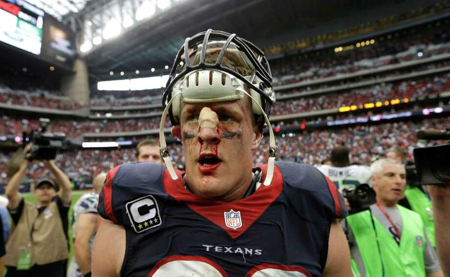 Houston Texans defensive end J.J. Watt has blood drip down his face after an overtime of an NFL football game against the Seattle Seahawks Sunday, Sept. 29, 2013, in Houston. Seattle won 23-20. (AP Photo/David J. Phillip) Photo: David J. Phillip, Associated Press / AP