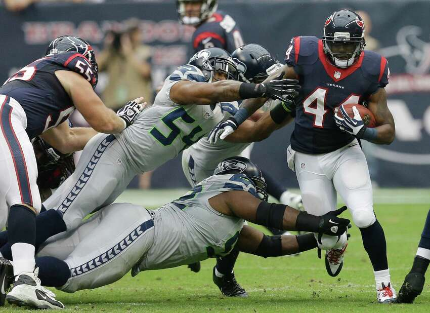 Houston Texans' Ben Tate (44) runs past Seattle Seahawks' Bobby Wagner (54) during the first quarter an NFL football game Sunday, Sept. 29, 2013, in Houston. (AP Photo/David J. Phillip)